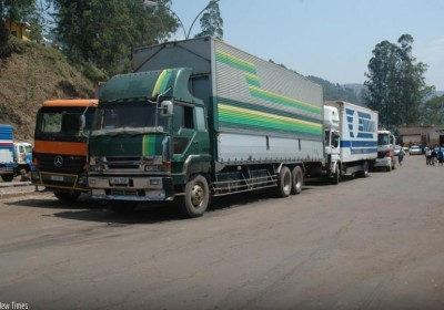 Trucks await clearance at Gatuna border between Rwanda and Uganda. (Timothy Kisambira)